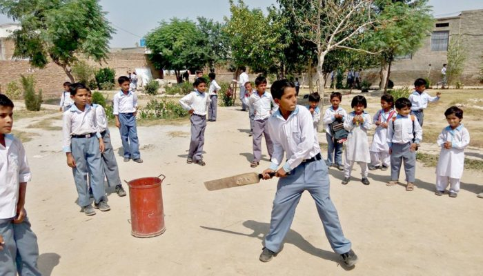 Student of Sher Ghar while playing cricket